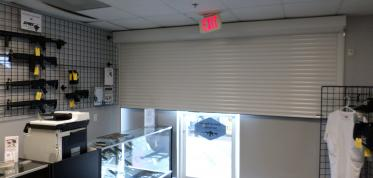 Gun stores: Roll Security Shutters and Grilles and Gates protect your store front from burglars